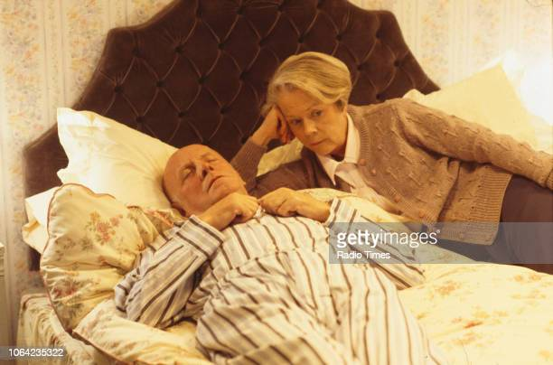 Actors Richard Wilson and Annette Crosbie in a bedroom scene from episode 'The Wisdom of the Witch' of the BBC Television sitcom 'One Foot in the...