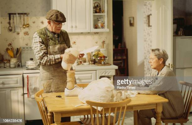 Actors Richard Wilson and Annette Crosbie in a kitchen scene from the Christmas special episode 'Starbound' of the BBC Television sitcom 'One Foot in...