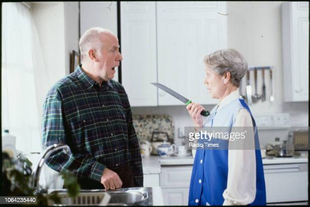 Actors Richard Wilson and Annette Crosbie in a kitchen scene from the BBC Television sitcom 'One Foot in the Grave' December 15th 1991