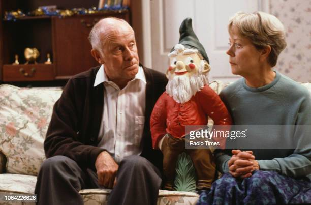 Actors Richard Wilson and Annette Crosbie with a large garden gnome in a scene from the Christmas special episode 'Who's Listening' of the television...