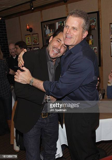 Actors Ricky Paull Goldin and Robert Newman attend the Spontaneous Construction premiere at Guys American Kitchen Bar on February 10 2013 in New York...