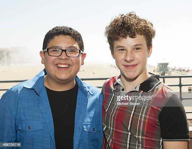 Actors Rico Rodriguez and Nolan Gould attend Mattel's 5th Annual Party On The Pier Hosted By Sarah Michelle Gellar at Santa Monica Pier on October 5...