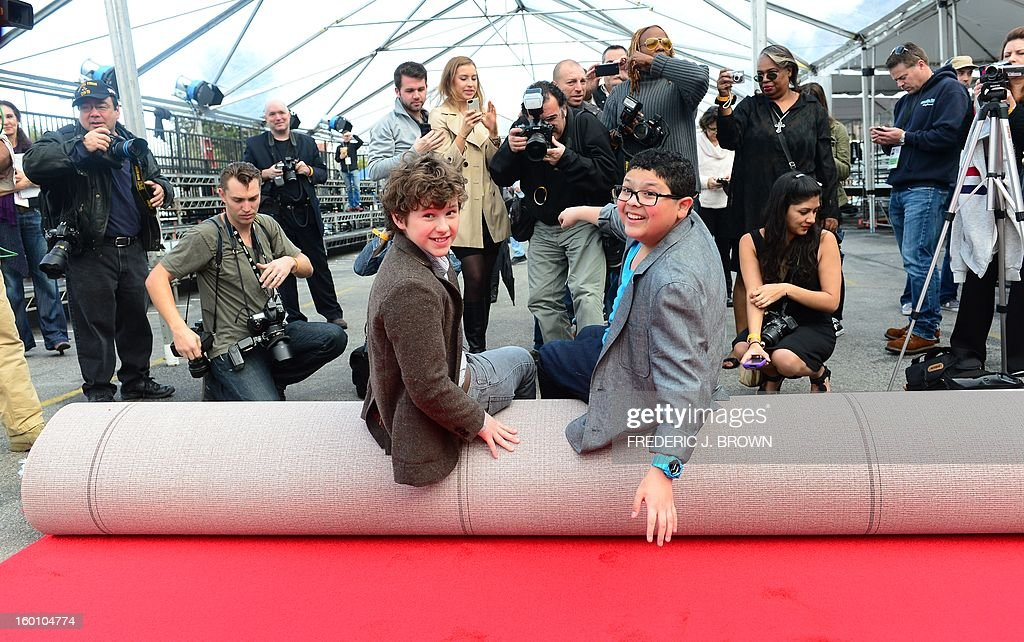 Actors Rico Rodriguez (R) and Nolan Gould (L) pose for the cameras after rolling out the red carpet in Los Angeles on January 26, 2013 during preparations ahead of the 19th Annual Screen Actors Guild (SAG) Awards on January 27. AFP PHOTO/Frederic J. BROWN