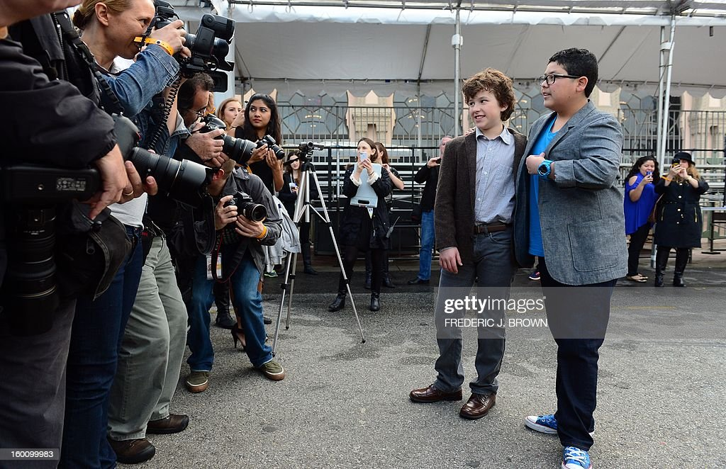 Actors Rico Rodriguez (R) and Nolan Gould (2nd R) pose for the cameras before rolling out the red carpet in Los Angeles on January 26, 2013 during preparations ahead of the 19th Annual Screen Actors Guild (SAG) Awards on January 27. AFP PHOTO/Frederic J. BROWN