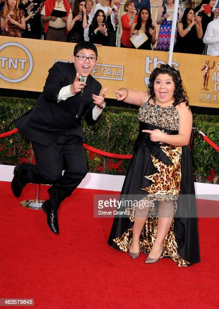 Actors Rico Rodriguez and Raini Rodriguez attend the 20th Annual Screen Actors Guild Awards at The Shrine Auditorium on January 18, 2014 in Los...