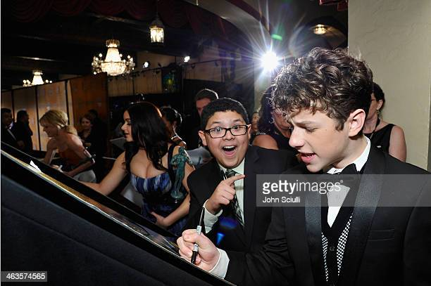 Actors Rico Rodriguez Ariel Winter and Nolan Gould attend the 20th Annual Screen Actors Guild Awards at The Shrine Auditorium on January 18 2014 in...