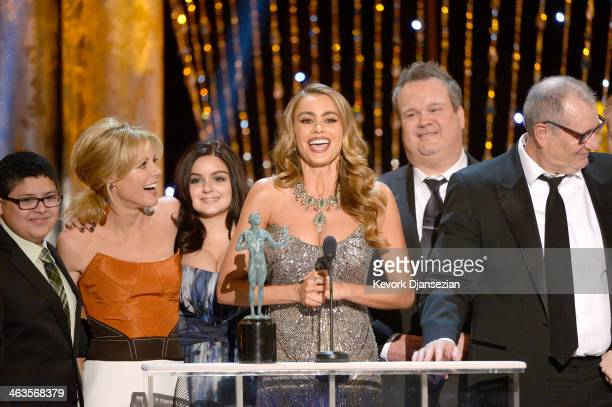 Actors Rico Rodriguez Julie Bowen Ariel Winter Sofia Vergara Eric Stonestreet and Ed O'Neill accept the Outstanding Performance by an Ensemble in a...