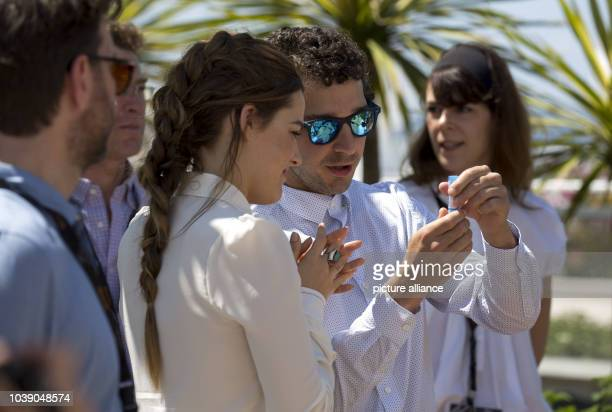 Actors Riley Keough and Shia LaBeouf attend the photocall of 'American Honey' during the 69th Annual Cannes Film Festival at Palais des Festivals in...