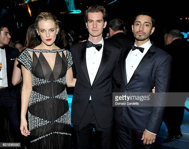 Actors Riley Keough Andrew Garfield and Riz Ahmed attend The 2017 InStyle and Warner Bros 73rd Annual Golden Globe Awards PostParty at The Beverly...