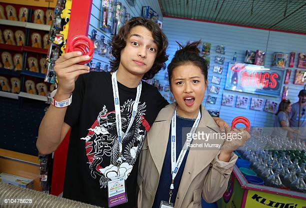 Actors Rio Mangini and Haley Tju help guests at the Ring Toss both during the 17th Annual Mattel Party on the Pier on September 25 2016 in Santa...