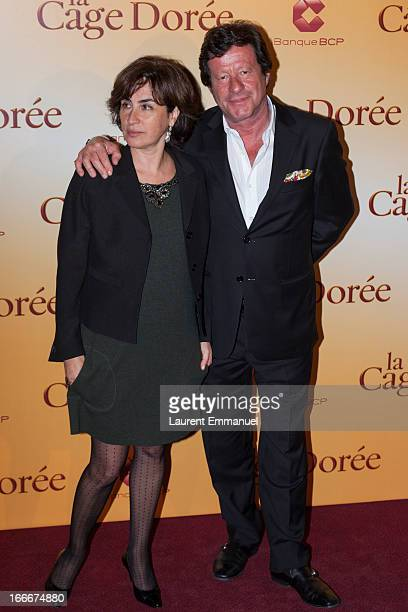 Actors Rita Blanco and Joaquim de Almeida pose during the premiere of the movie La Cage Doree at Cinema Gaumont Marignan on April 15 2013 in Paris...