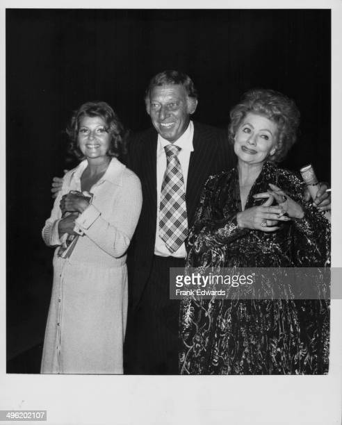Actors Rita Hayworth and Lucille Ball with comedian Gary Morton at the Dorothy Chandler Pavilion for a performance of 'Gigi' Los Angeles July 1973