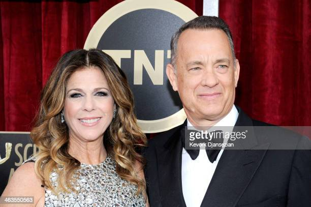 Actors Rita Wilson and Tom Hanks attend the 20th Annual Screen Actors Guild Awards at The Shrine Auditorium on January 18 2014 in Los Angeles...