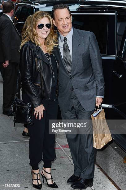 """Actors Rita Wilson and Tom Hanks leave the """"Late Show With David Letterman"""" taping at the Ed Sullivan Theater on May 18, 2015 in New York City."""