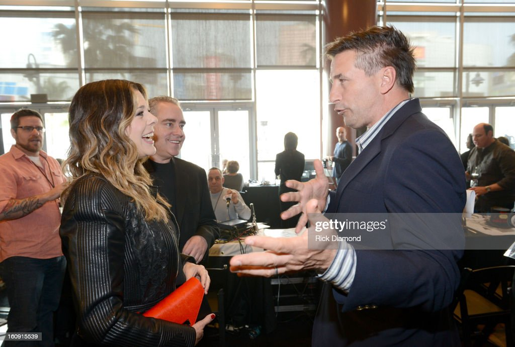 Actors Rita Wilson (L) and William Baldwin pose backstage at the GRAMMYs Dial Global Radio Remotes during The 55th Annual GRAMMY Awards at the STAPLES Center on February 7, 2013 in Los Angeles, California.
