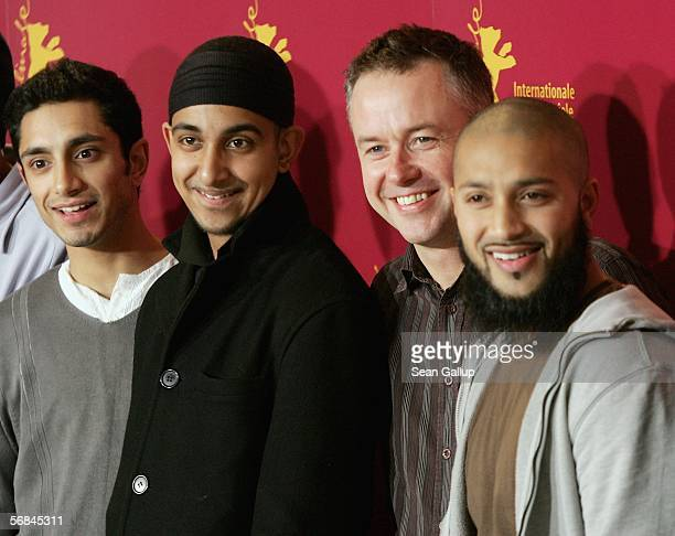 Actors Riz Ahmed Arfan Usman director Michael Winterbotton and former inmate of Guantanamo Bay Prison Camp Ruhel Ahmed attend the photocall of The...