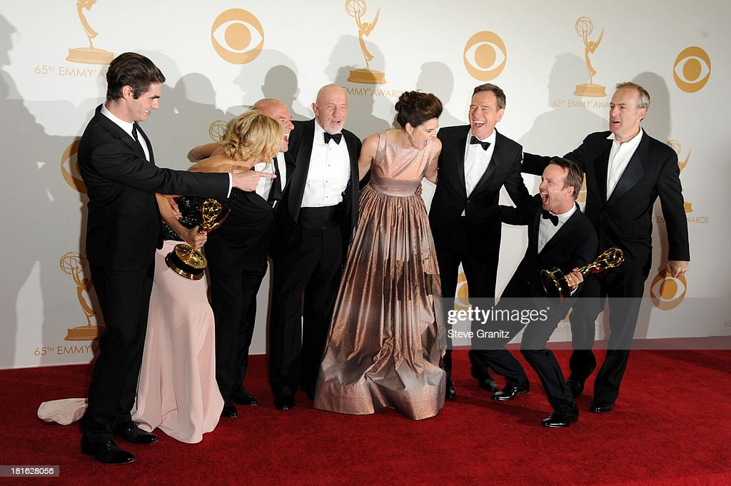 Actors RJ Mitte, Anna Gunn, Dean Norris, Betsy Brandt, Bryan Cranston, Aaron Paul, Bob Odenkirk and Jonathan Banks pose in the press room during the 65th Annual Primetime Emmy Awards held at Nokia Theatre L.A. Live on September 22, 2013 in Los Angeles, California.