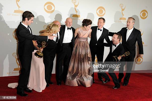 Actors RJ Mitte, Anna Gunn, Dean Norris, Betsy Brandt, Bryan Cranston, Aaron Paul, Bob Odenkirk and Jonathan Banks pose in the press room during the...