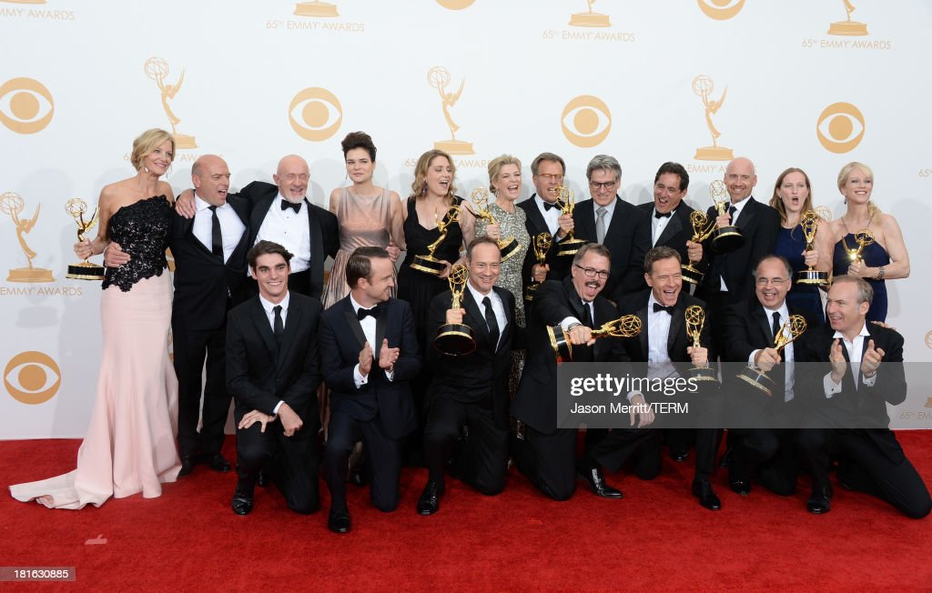 Actors RJ Mitte, Anna Gunn, Dean Norris, Betsy Brandt, Bryan Cranston, Aaron Paul, Bob Odenkirk and Jonathan Banks with show creator Vince Gilligan and producers, winners of the Best Drama Series Award for 'Breaking Bad' pose in the press room during the 65th Annual Primetime Emmy Awards held at Nokia Theatre L.A. Live on September 22, 2013 in Los Angeles, California.
