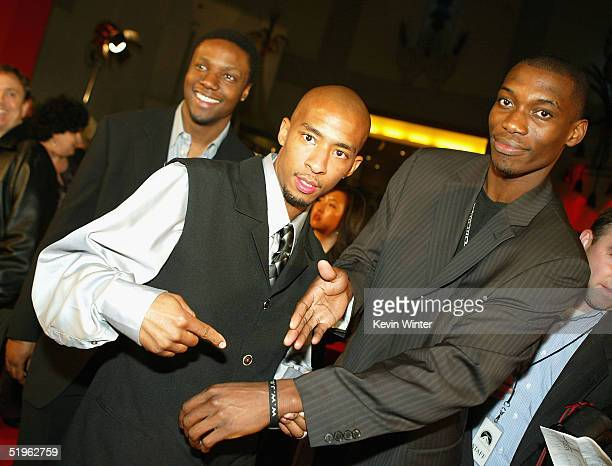 Actors Rob Brown Antwon Tanner and Nana Gbewonyo pose at the premiere of Paramounts' Coach Carter at the Chinese Theater on January 13 2005 in Los...