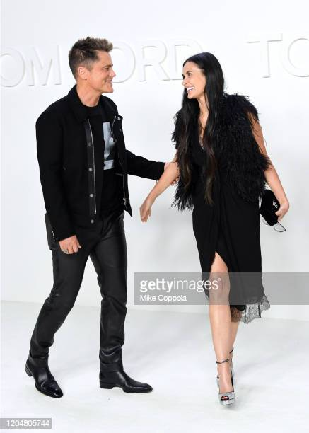 Actors Rob Lowe and Demi Moore attend the Tom Ford AW20 Show Arrivals at Milk Studios on February 07 2020 in Hollywood California