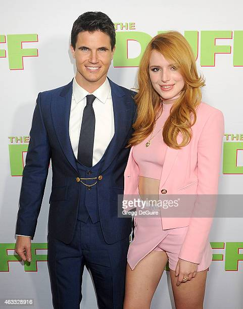 Actors Robbie Amell and Bella Thorne arrive at the Los Angeles screening of 'The Duff' at TCL Chinese 6 Theatres on February 12 2015 in Hollywood...