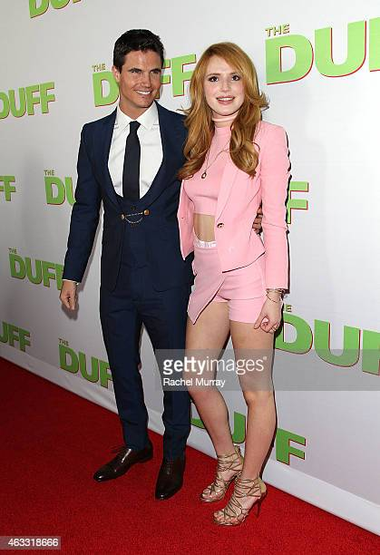 Actors Robbie Amell and Bella Thorne attend a special Los Angeles fan screening of THE DUFF on February 12 2015 in Los Angeles California