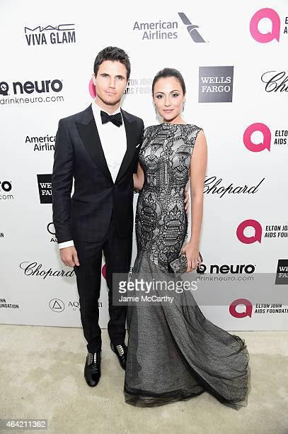 Actors Robbie Amell and Italia Ricci attend the 23rd Annual Elton John AIDS Foundation Academy Awards Viewing Party on February 22 2015 in Los...