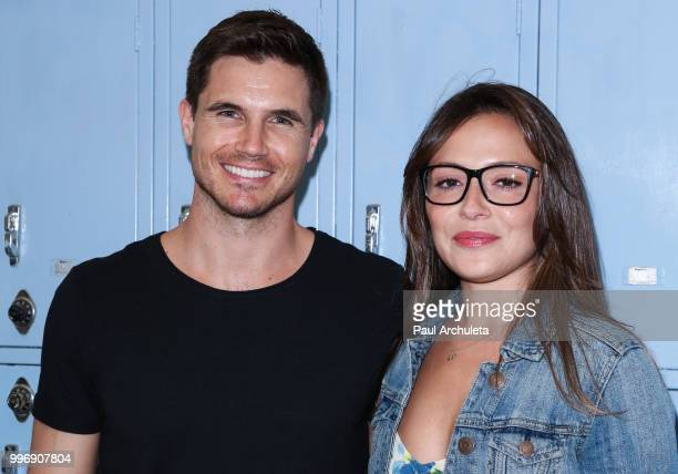Actors Robbie Amell and Italia Ricci attend the screening of A24's 'Eighth Grade' at Le Conte Middle School on July 11 2018 in Los Angeles California