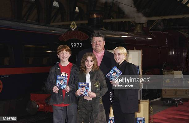 Actors Robbie Coltrane Rupert Grint Emma Watson and Tom Felton at the 'Harry Potter and The Philosopher's Stone' DVD launch party held on platform 9...