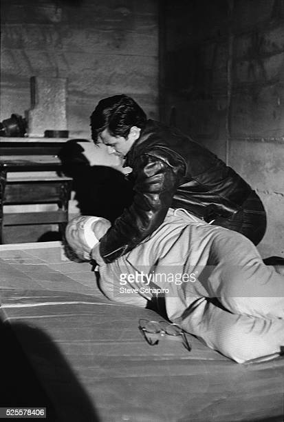 Actors Robert Blake and John McLiam reenact the killing of Herbert Blake while filming a scene from the movie In Cold Blood based on Truman Capote's...