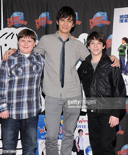 Actors Robert Capron,Devon Bostick and Zack Gordon visit Planet Hollywood Times Square on March 16, 2011 in New York City.