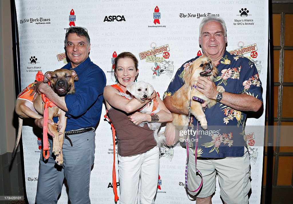 Actors Robert Cuccioli, Isabel Keating and Michael Mulheren attend the Broadway Barks 15th Animal Adoption Event at Shubert Alley on July 13, 2013 in New York City.