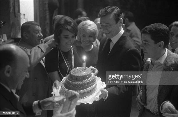 Actors Robert Dalban Pascale Roberts Yves Montand and Philippe Nicaud at Pierre Mondy's birthday at the Théâtre de la Renaissance in Paris France in...