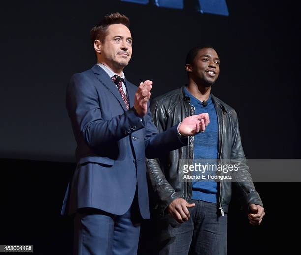 Actors Robert Downey Jr and Chadwick Boseman onstage during Marvel Studios fan event at The El Capitan Theatre on October 28 2014 in Los Angeles...
