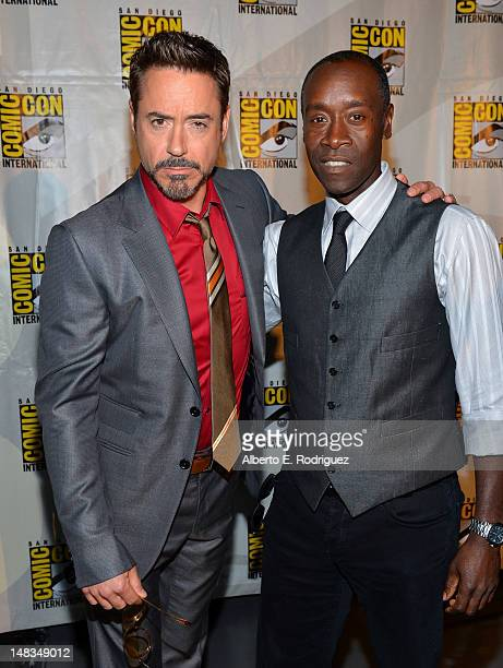 """Actors Robert Downey Jr. And Don Cheadle arrive at the """"Iron Man 3"""" panel with Marvel Studios during Comic-Con International 2012 at San Diego..."""