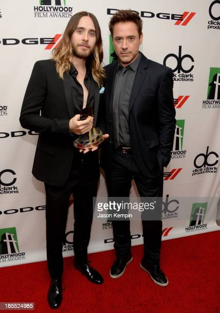 Actors Robert Downey Jr and Jared Leto pose in the press room during the 17th annual Hollywood Film Awards at The Beverly Hilton Hotel on October 21...