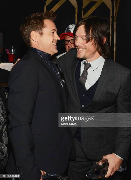 Actors Robert Downey Jr and Norman Reedus backstage at The 40th Annual People's Choice Awards at Nokia Theatre LA Live on January 8 2014 in Los...