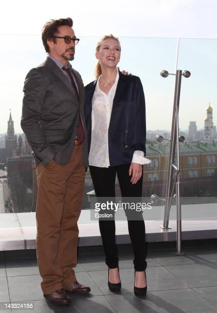 Actors Robert Downey, Jr and Scarlett Johansson pose for photo on the roof of Ritz Carlton hotel before 'Marvel's The Avengers' premiere on April 17,...
