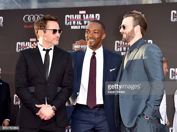 Actors Robert Downey Jr Anthony Mackie and Chris Evans attend the premiere of Marvel's 'Captain America Civil War' at Dolby Theatre on April 12 2016...
