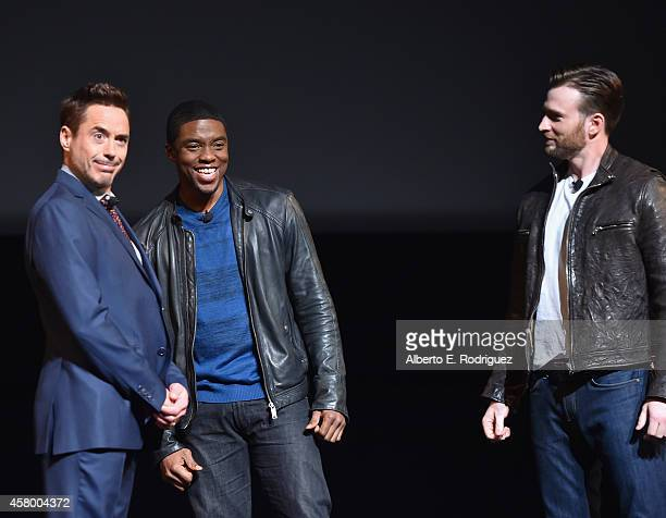 Actors Robert Downey Jr Chadwick Boseman and Chris Evans onstage during Marvel Studios fan event at The El Capitan Theatre on October 28 2014 in Los...