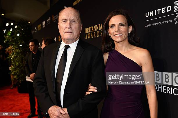 Actors Robert Duvall and Luciana Pedraza attend the BAFTA Los Angeles Jaguar Britannia Awards presented by BBC America and United Airlines at The...