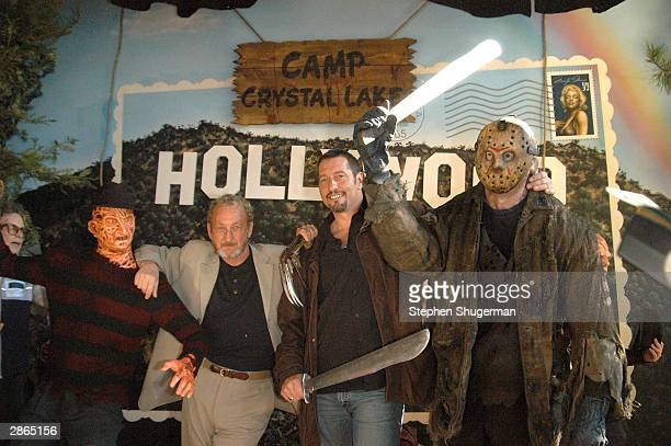 Actors Robert Englund and Ken Kirzinger pose with Hollywood Wax Mueum figures of Freddy and Jason at the unveiling to celebrate the debut of the DVD...