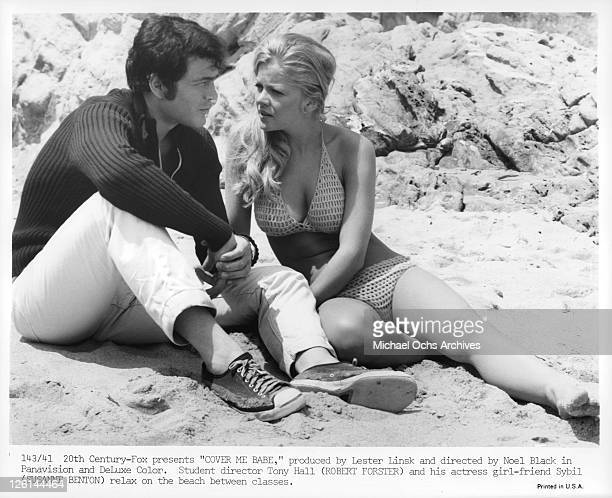 Robert Forster sitting on the beach with girlfriend Susanne Benton in a scene from the film 'Cover Me Babe' 1970 Photo by 20th CenturyFox/Getty Images