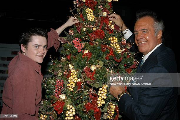 Actors Robert Iler and Tony Sirico helps to decorate a Christmas tree during the 14th annual HeartShare Tree Trim auction and charity festival at the...