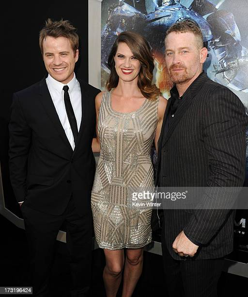 Actors Robert Kazinsky Heather Doerksen and Max Martini arrive at the premiere of Warner Bros Pictures' and Legendary Pictures' Pacific Rim at Dolby...