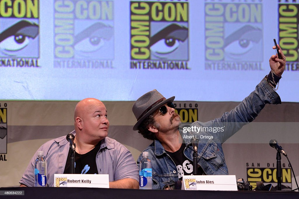 Actors Robert Kelly (L) and John Ales take a selfie at the FX TV Block featuring 'Sex&Drugs&Rock&Roll,' 'The Strain,' and a sneak peek of 'The Bastard Executioner' panel during Comic-Con International 2015 at the San Diego Convention Center on July 12, 2015 in San Diego, California.