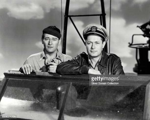 Actors Robert Montgomery as Lt John Brickley and John Wayne as Lt Rusty Ryan in the war film 'They Were Expendable' 1945