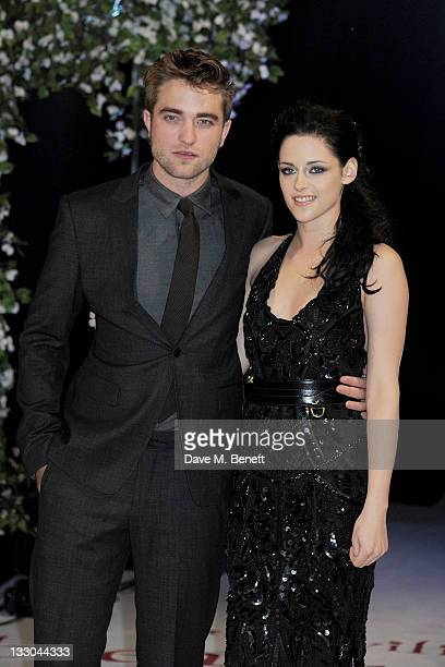 Actors Robert Pattinson and Kristen Stewart attend the UK Premiere of 'The Twilight Saga Breaking Dawn Part 1' at Westfield Stratford City on...