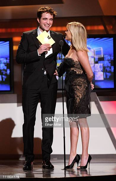Actors Robert Pattinson and Reese Witherspoon speak onstage at the 46th Annual Academy Of Country Music Awards held at the MGM Grand Garden Arena on...